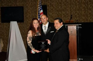 "The Bail Bond Queen® receiving the award for ""Businessperson of the year"" from the Nassau County Sheriff's Department"